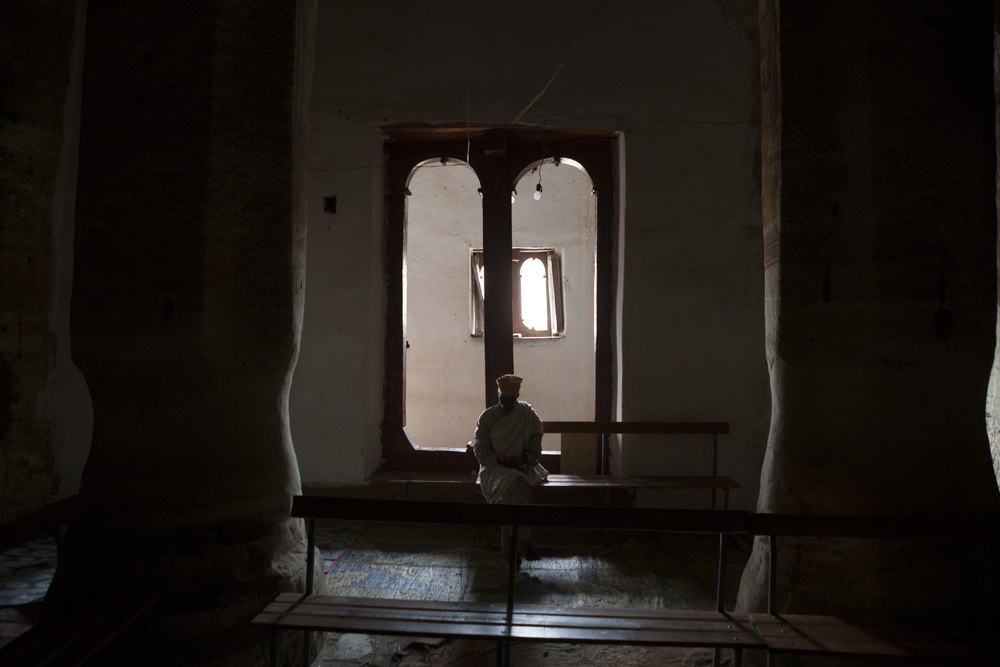 A priest is pictured inside the Miriam Korkor Church. The church is completely carved of solid rock, dating back to the 4th century in local records, though historians have dated it around 11th century.