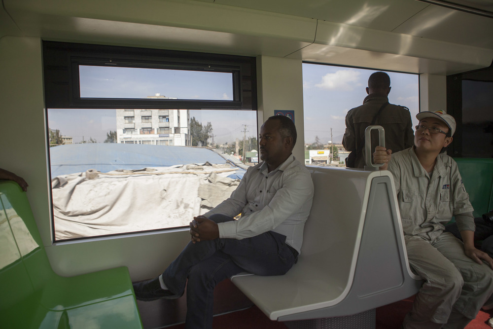 An Ethiopian passenger and Chinese contractor are pictured on a test run of the Addis Ababa lightrail. AFP Photo Zacharias Abubeker