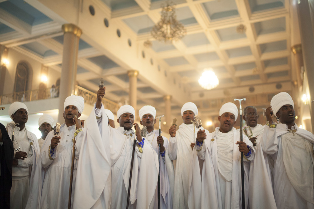 Priests are pictured leading the prayers during an Easter celebration in Addis Ababa on 11 April 2015. AFP Photo / Zacharias Abubeker