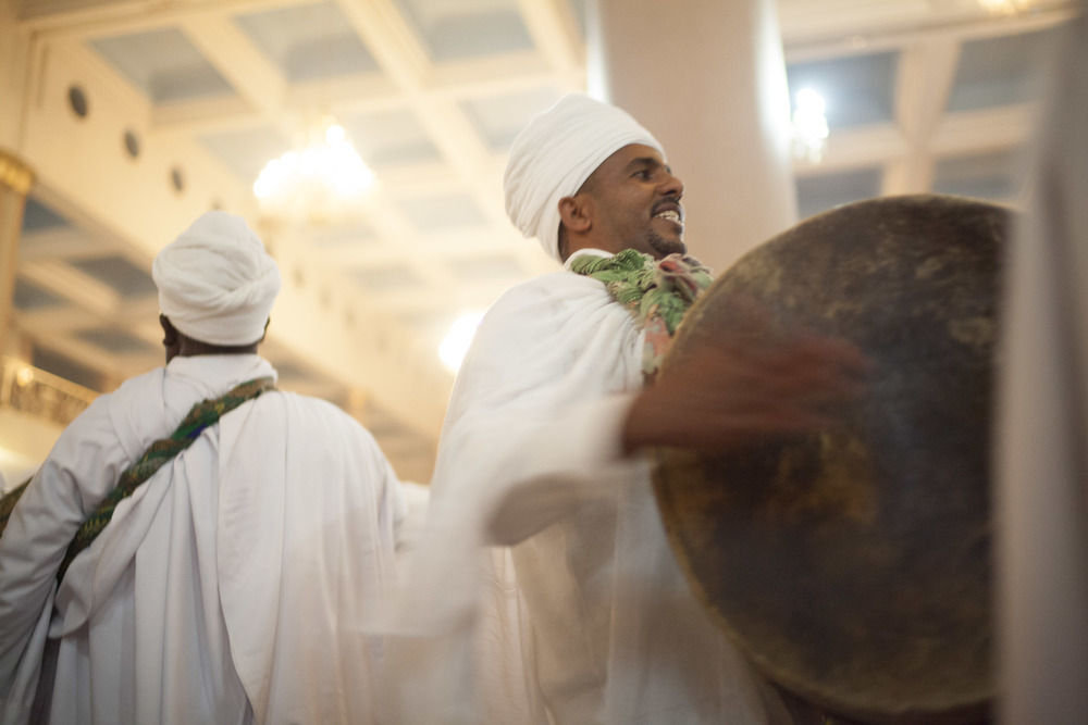 Priests are pictured drumming with the prayers during an Easter celebration in Addis Ababa on 11 April 2015. AFP Photo / Zacharias Abubeker