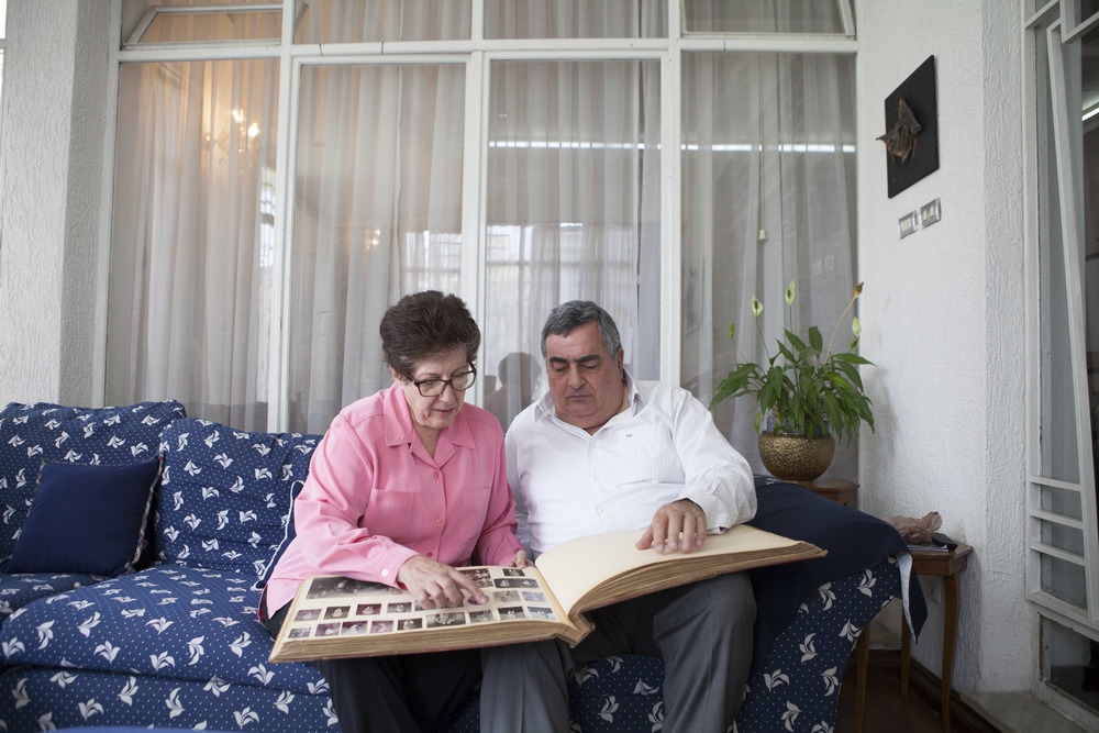 Mary and Vartkes Nalbanian, Ethiopian born Armenians, are pictured looking at old family pictures of Armenians in Ethiopian on 20 April 2015. The Nalbanian is one of the few remaining Armenian Ethiopian families living in Addis Ababa. There are roughly Ethiopian born Armenians living in Addis Ababa currently. AFP Photo / Zacharias Abubeker