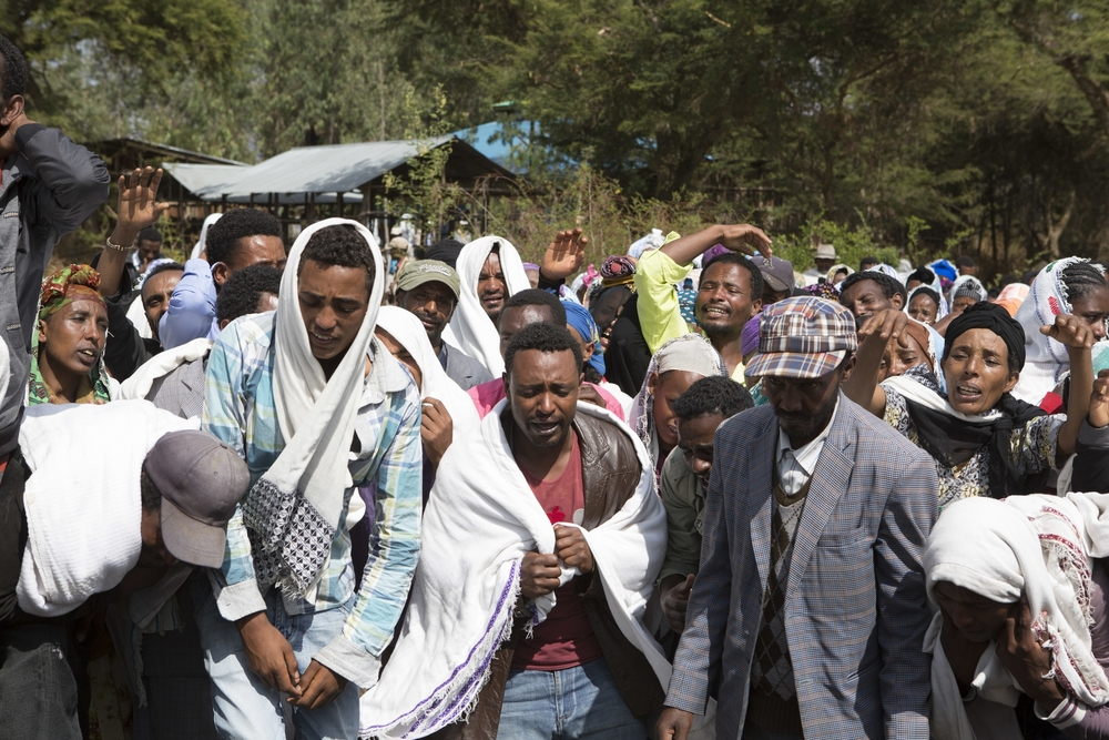 "People are pictured mourning the death of Dinka Chala in Yubdo Village, about 100km from Addis Ababa in the Oromia region on 17 Dec 2015. Dinka Chala was shot dead by the Ethiopian Defense the day earlier. He was accused of protesting, but his family says he was not involved. Tensions have been riding high between the population of Oromia, and the Federal Government of Ethiopia. The population of Oromia are unhappy with the current ""Master Plan"" which is overtaking Oromo lands surrounding Addis Ababa. The protests have been ongoing for the past three weeks, with government responding in force with live ammunition. The Government also claims death tolls of around 5, the unofficial figure made by protesters has reached up to 40+."