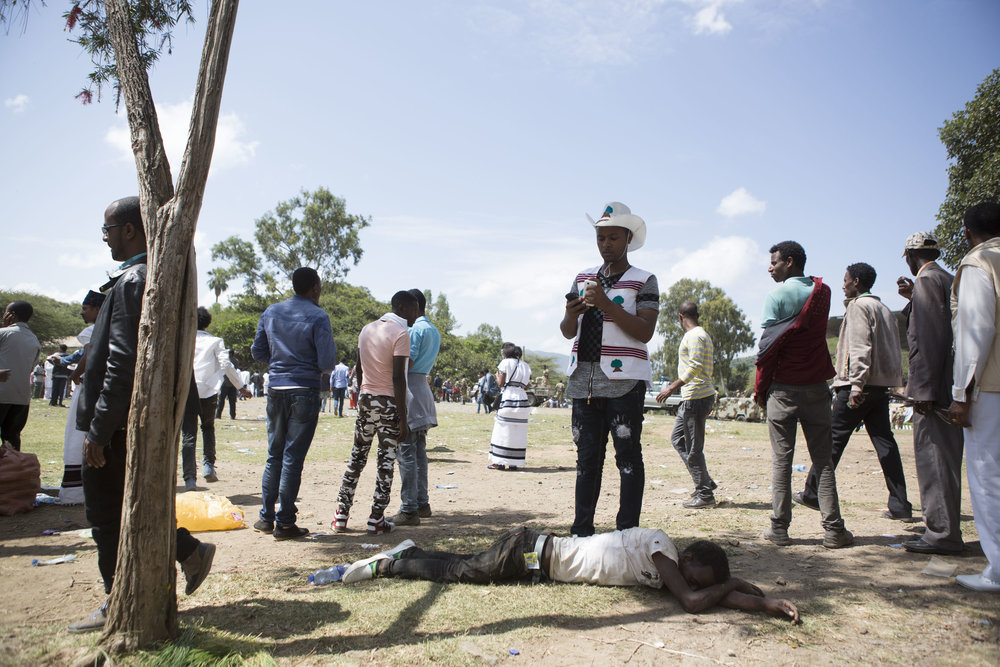 A man lies injured after a stampede occurred at the Oromo festival of Irreecha.
