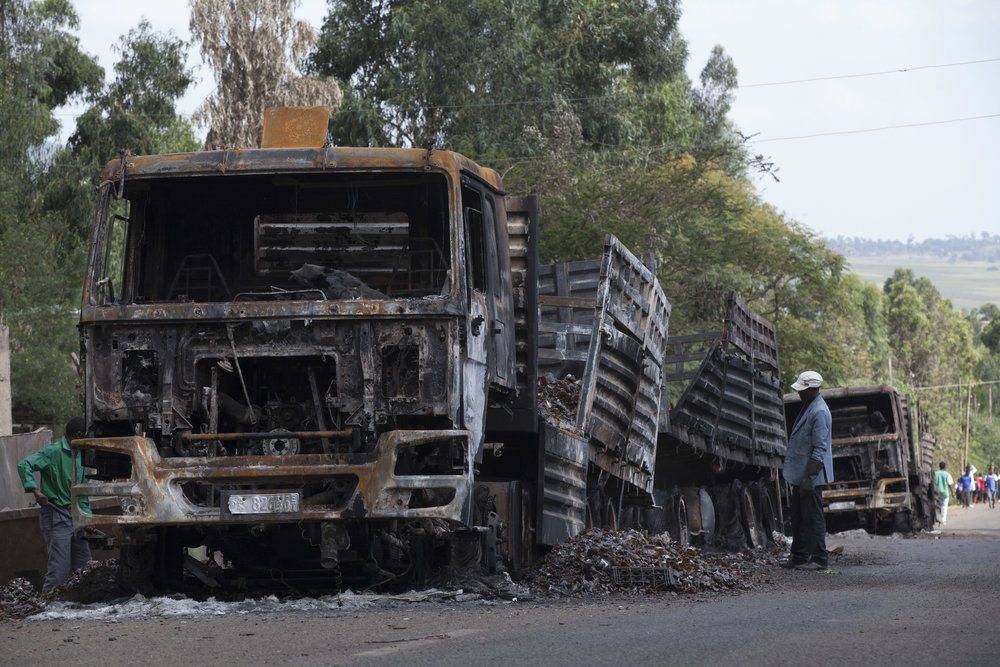 A destroyed truck sits nearby the Meta brewing factory, in Sebeta, Ethiopia. Credit: Zacharias Abubeker / AFP