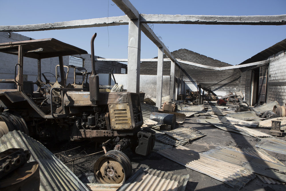 A destroyed workshop on the compound of Africa Juice, a Dutch owned juice factory, about two hours south of Addis Ababa, outside of Adama town. Credit: Zacharias Abubeker / AFP