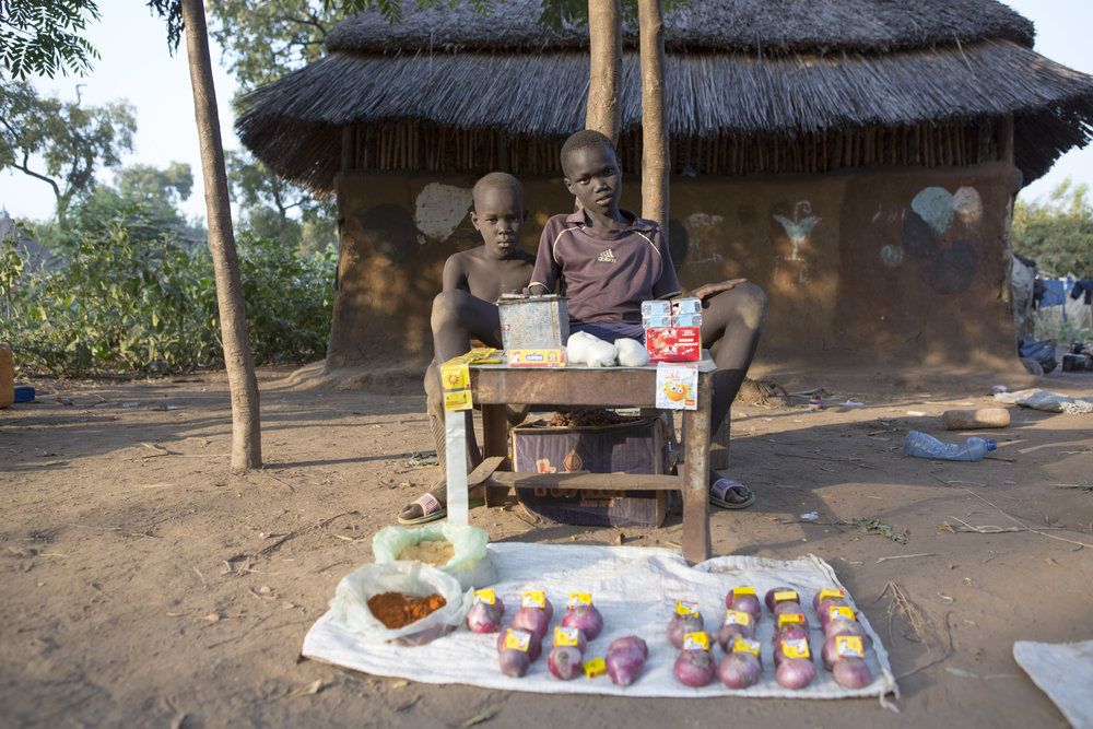 Two young boys sell goods outside of their family's home in the Kule Refugee camp for South Sudanese in the Gambella region of Ethiopia on 25 Nov 2017. MSF / Zacharias Abubeker