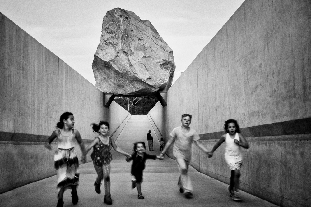 lacma-levitating-rock-children-running-under-it.jpg