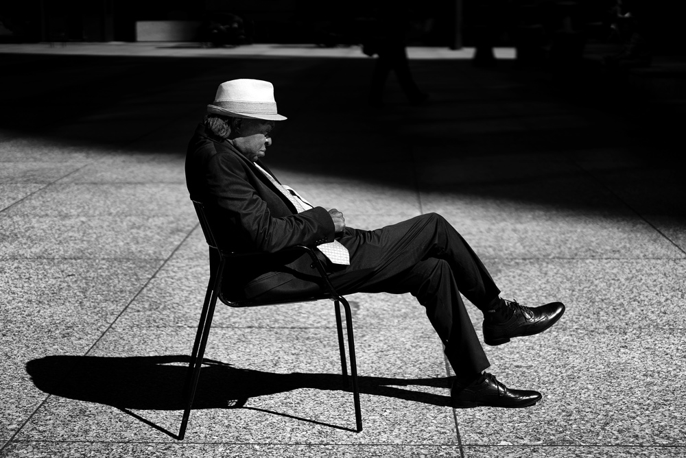 man-sleeping-daly-center-plaza-chicago.jpg