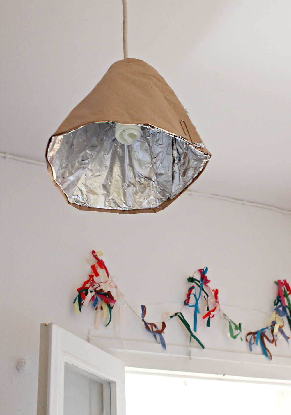 Recycled lamp fixture made from paper towel rolls & aluminum foil.jpg