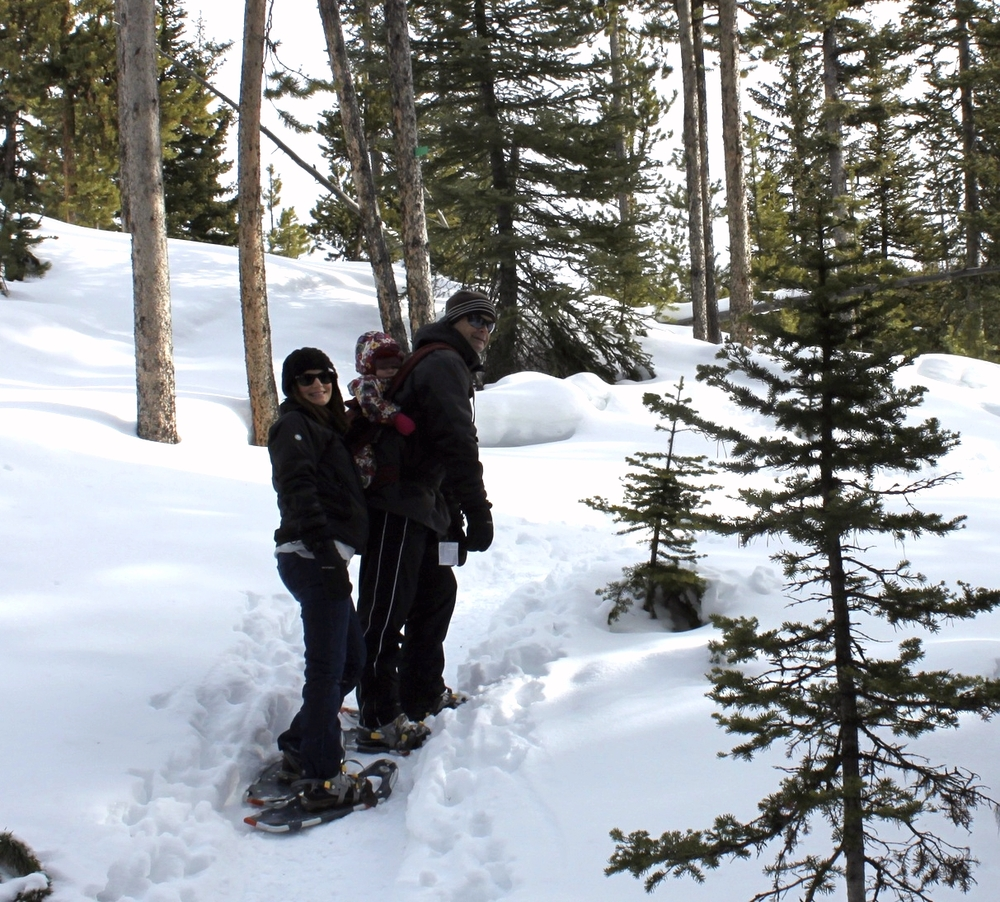 My dad and I snowshoeing with Grace at Big Sky, Montana.