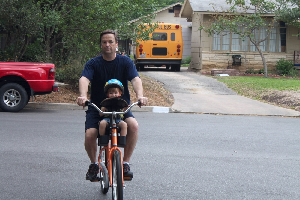 My dad and Gracie riding my bike in San Antonio.