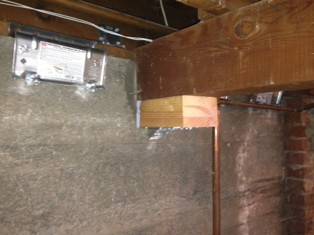 Concrete wall, post and beam retrofit image by  Earthquake Tech .