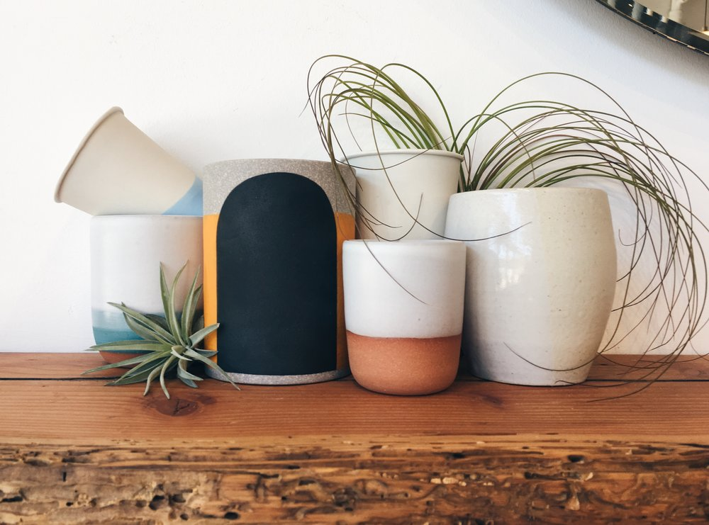 Tumbler style and Espresso mug options by  Candy Relics  (Portland),  Pawena  (Los Angeles),  Wolf Ceramics  (Portland),  Tamara Bryan  (Portland)   (Bonus design tip: these non-handle mugs also make for very cute small planters, perfect for succulents!)