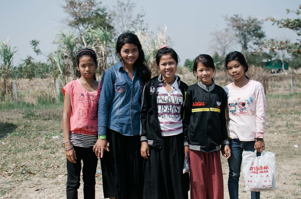 The school aged girls in the program leaving for school after a morning with LandMine Design. Srey Mom is second from the left, Volek stands beside her in the middle, and Som Poa is all the way on the right.