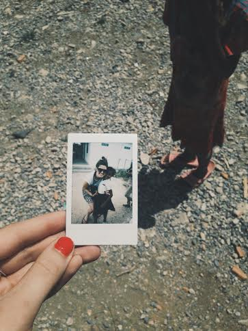 This little girl ran up to our Creative Manager, Kristie, and tugged on her shirt and pulled this perfectly kept polaroid from trips prior from her tattered little pocket. Reminder of the importance of the little moments.