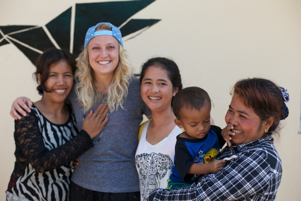 Te and her new baby with some of the Landmine Design family!