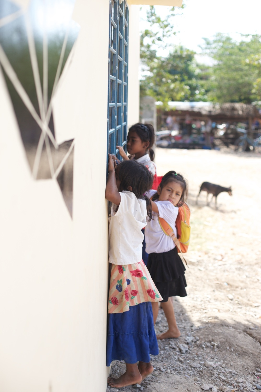 Children of The MineField Village peeking into Landmine Design