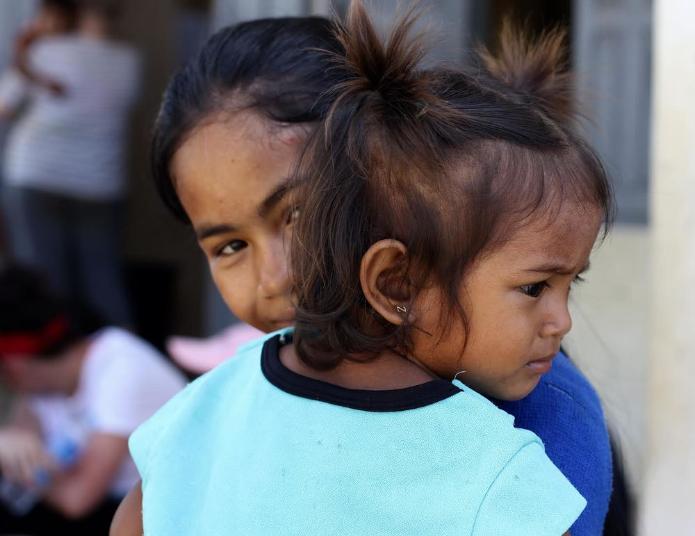 Som Kim's two daughters, the older almost subjected to slavery out of desperation.