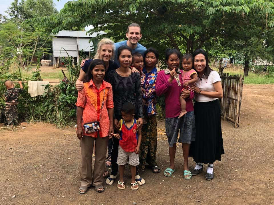 Director Karla and Zach stand with the new Landmine Design Artisans in Cambodia in January 2018