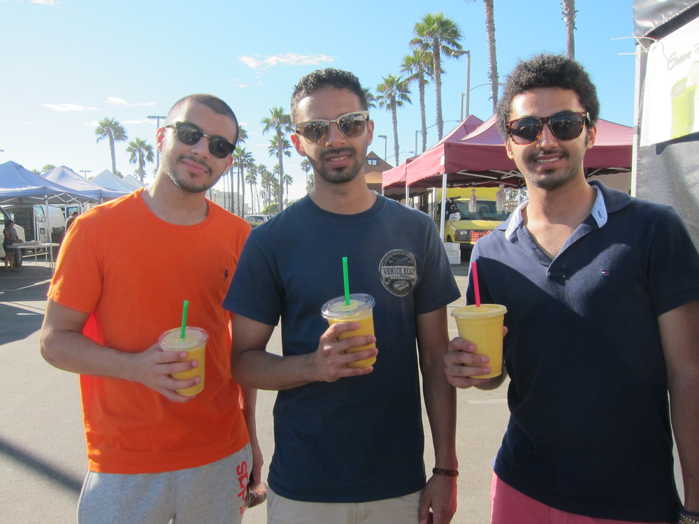 Tourists from Saudi Arabia enjoying their Mango smoothies.  (Photo by Lauren Lloyd)