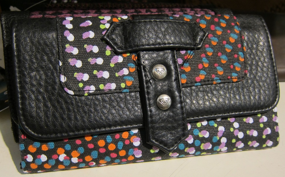 Any ladies need a new $28 wallet? This cute polkadot  Roxy  design adds a little color to paying the bills, and as the sister company to  Quiksilver , she's based right here in Surf City.  (Photo by Lauren Lloyd)