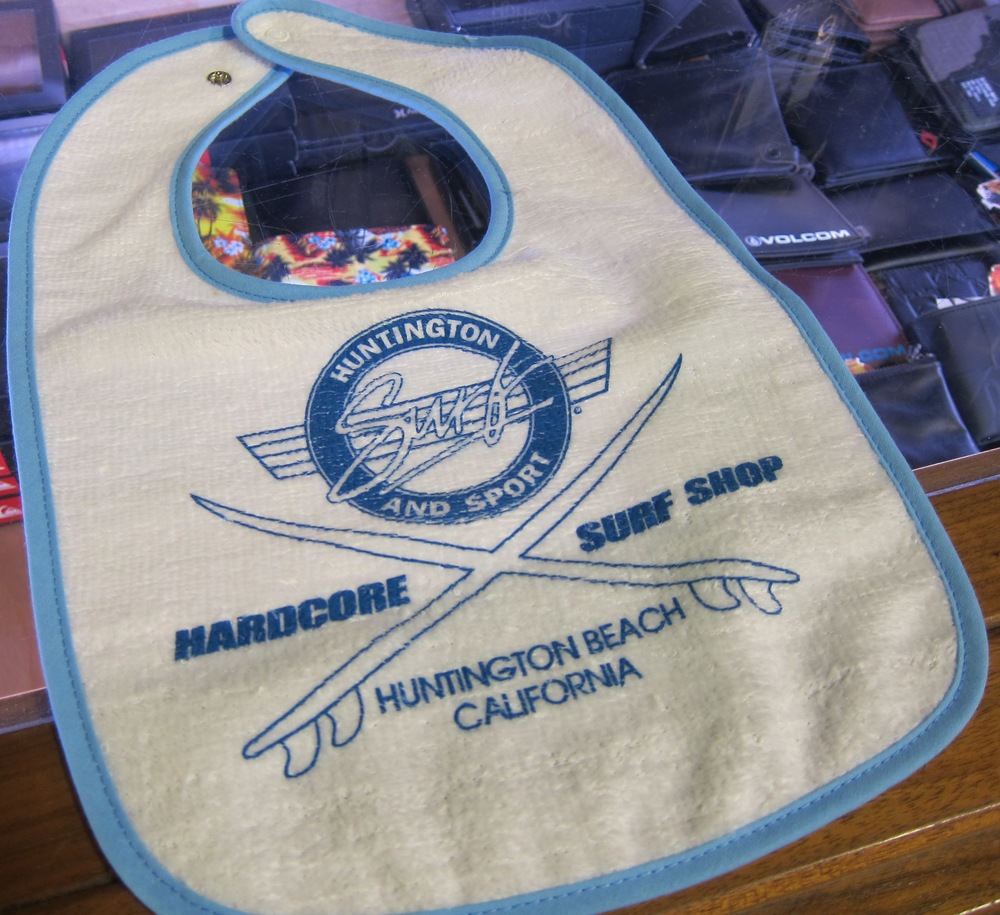 Hardcore kiddos can keep clean and represent HB with this $8  HSS  bib. Parents, you could probably use one of these as well.  (Photo by Lauren Lloyd)