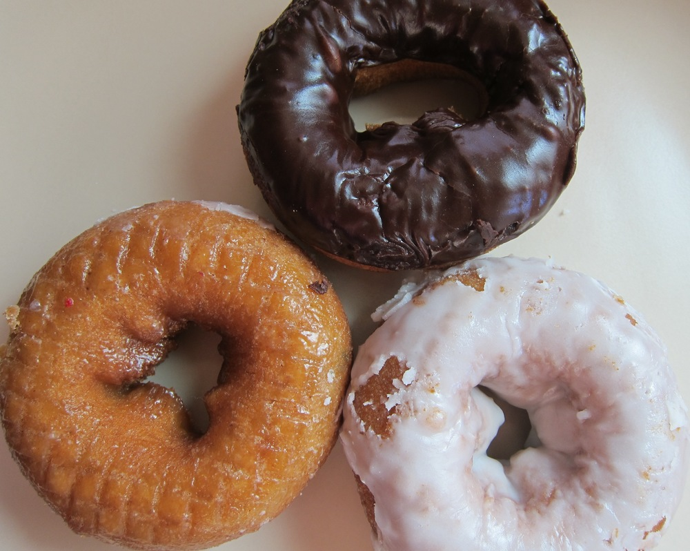 Pumpkin vegan cake doughnuts (glazed, vanilla frosted and chocolate fudge frosted) (Photo by Lauren Lloyd)