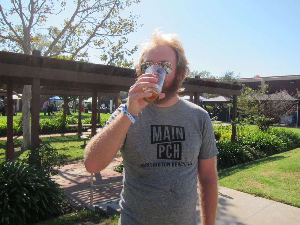 Hudson Wise chugs a delicious  Hangar 24  Oktoberfest while sporting his  Main & PCH tee   (Photo by Lauren Lloyd)