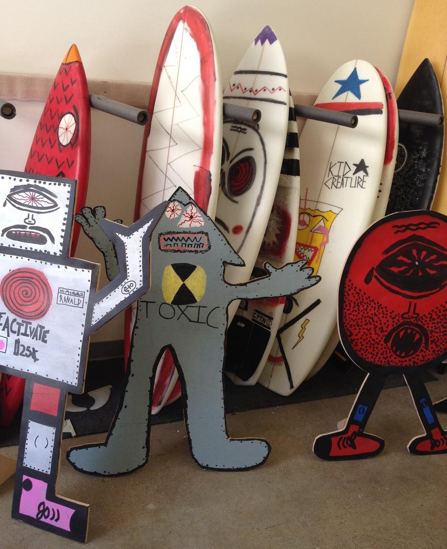Inside Kid Creature's studio: Kid Creature creations, including cardboard creatures and surfboards  (Photo by Lauren Lloyd)