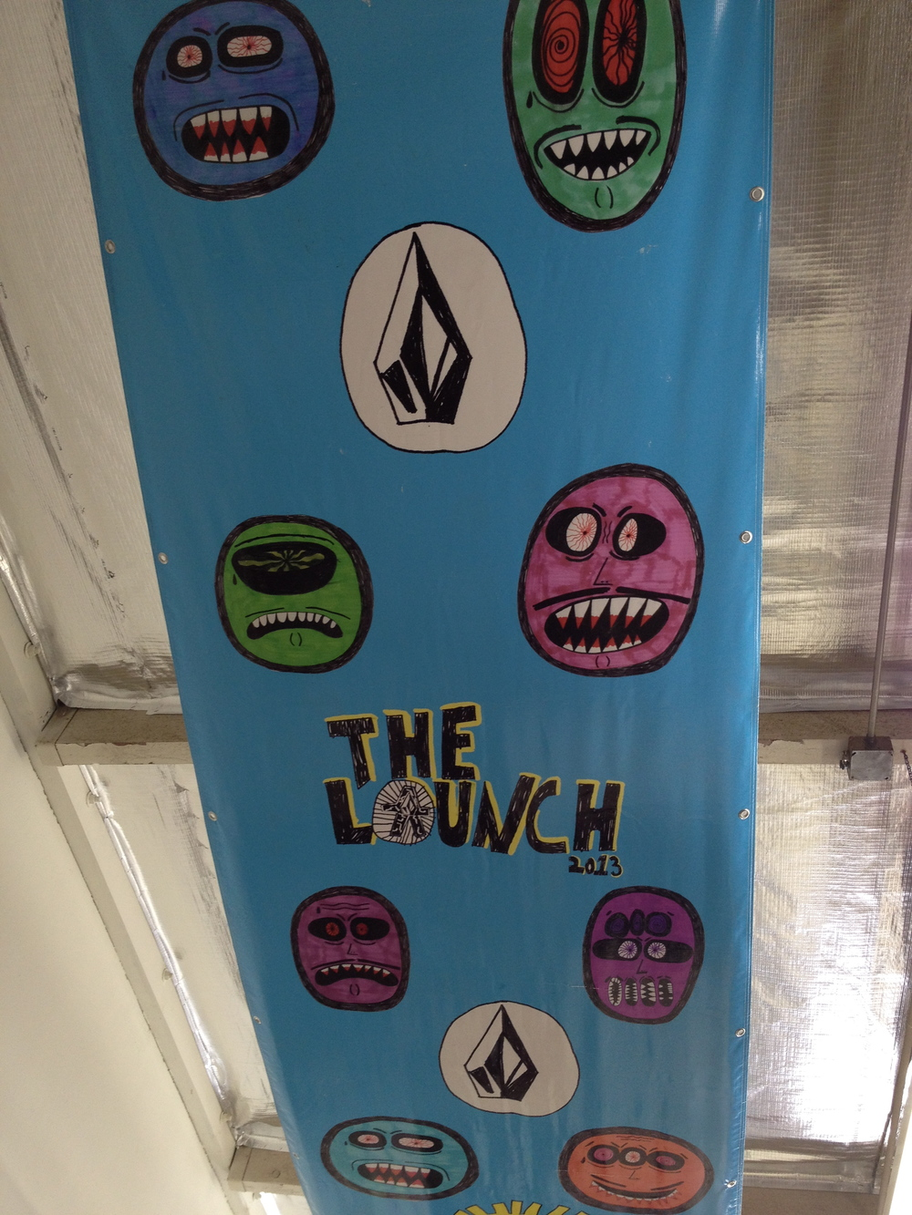 Inside Kid Creature's studio: Bear Mountain'sVolcom-sponsored The Launch 2013 banner (Photo by Lauren Lloyd)