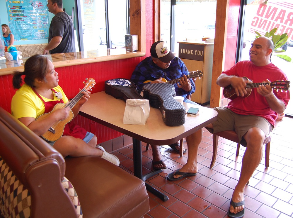 """Leo and her Hawaiian music group practicing at Dough Dough's Hawaiian Malasadas (Photo by Lauren Lloyd)                               0    false          18 pt    18 pt    0    0       false    false    false                                               /* Style Definitions */ table.MsoNormalTable {mso-style-name:""""Table Normal""""; mso-tstyle-rowband-size:0; mso-tstyle-colband-size:0; mso-style-noshow:yes; mso-style-parent:""""""""; mso-padding-alt:0in 5.4pt 0in 5.4pt; mso-para-margin-top:0in; mso-para-margin-right:0in; mso-para-margin-bottom:10.0pt; mso-para-margin-left:0in; mso-pagination:widow-orphan; font-size:12.0pt; font-family:""""Times New Roman""""; mso-ascii-font-family:Cambria; mso-ascii-theme-font:minor-latin; mso-fareast-font-family:""""Times New Roman""""; mso-fareast-theme-font:minor-fareast; mso-hansi-font-family:Cambria; mso-hansi-theme-font:minor-latin;}"""