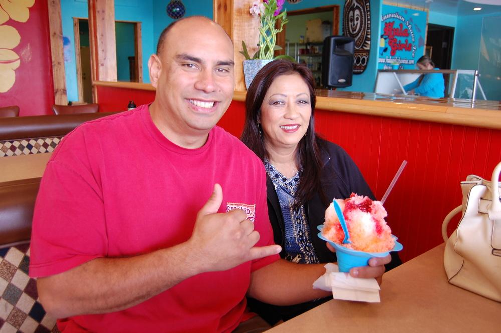"Enjoying a Hula Girls Hawaiian Shave Ice on the Dough Dough's Hawaiian Malasadas side (Photo by Lauren Lloyd)                               0    false          18 pt    18 pt    0    0       false    false    false                                               /* Style Definitions */ table.MsoNormalTable {mso-style-name:""Table Normal""; mso-tstyle-rowband-size:0; mso-tstyle-colband-size:0; mso-style-noshow:yes; mso-style-parent:""""; mso-padding-alt:0in 5.4pt 0in 5.4pt; mso-para-margin-top:0in; mso-para-margin-right:0in; mso-para-margin-bottom:10.0pt; mso-para-margin-left:0in; mso-pagination:widow-orphan; font-size:12.0pt; font-family:""Times New Roman""; mso-ascii-font-family:Cambria; mso-ascii-theme-font:minor-latin; mso-fareast-font-family:""Times New Roman""; mso-fareast-theme-font:minor-fareast; mso-hansi-font-family:Cambria; mso-hansi-theme-font:minor-latin;}                                           0    false          18 pt    18 pt    0    0       false    false    false                                               /* Style Definitions */ table.MsoNormalTable {mso-style-name:""Table Normal""; mso-tstyle-rowband-size:0; mso-tstyle-colband-size:0; mso-style-noshow:yes; mso-style-parent:""""; mso-padding-alt:0in 5.4pt 0in 5.4pt; mso-para-margin-top:0in; mso-para-margin-right:0in; mso-para-margin-bottom:10.0pt; mso-para-margin-left:0in; mso-pagination:widow-orphan; font-size:12.0pt; font-family:""Times New Roman""; mso-ascii-font-family:Cambria; mso-ascii-theme-font:minor-latin; mso-fareast-font-family:""Times New Roman""; mso-fareast-theme-font:minor-fareast; mso-hansi-font-family:Cambria; mso-hansi-theme-font:minor-latin;}                                       0    false          18 pt    18 pt    0    0       false    false    false                                               /* Style Definitions */ table.MsoNormalTable {mso-style-name:""Table Normal""; mso-tstyle-rowband-size:0; mso-tstyle-colband-size:0; mso-style-noshow:yes; mso-style-parent:""""; mso-padding-alt:0in 5.4"