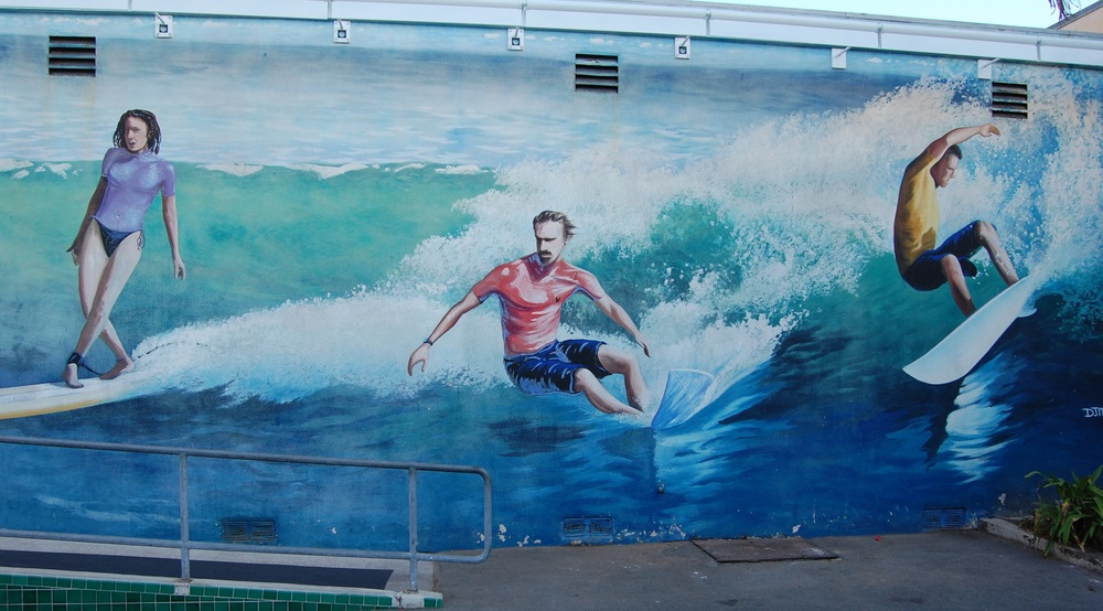 Surfing mural on exterior wall of the International Surfing Museum  (Photo by Lauren Lloyd)