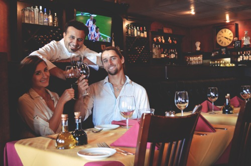 Capone's Cucina with owner/chef Dino Ferraro and friend Rebekah Schaefer (Photo by Arielle Warren)