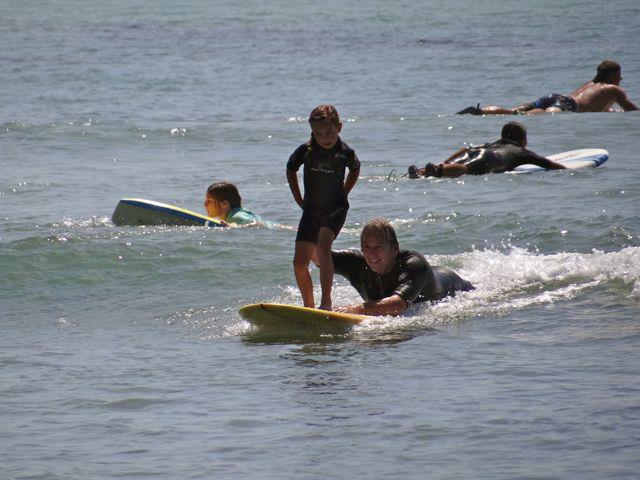 Ed Sakal teaching his granddaughter, Keira, to surf (Photo courtesy of Sakal Surfboards)