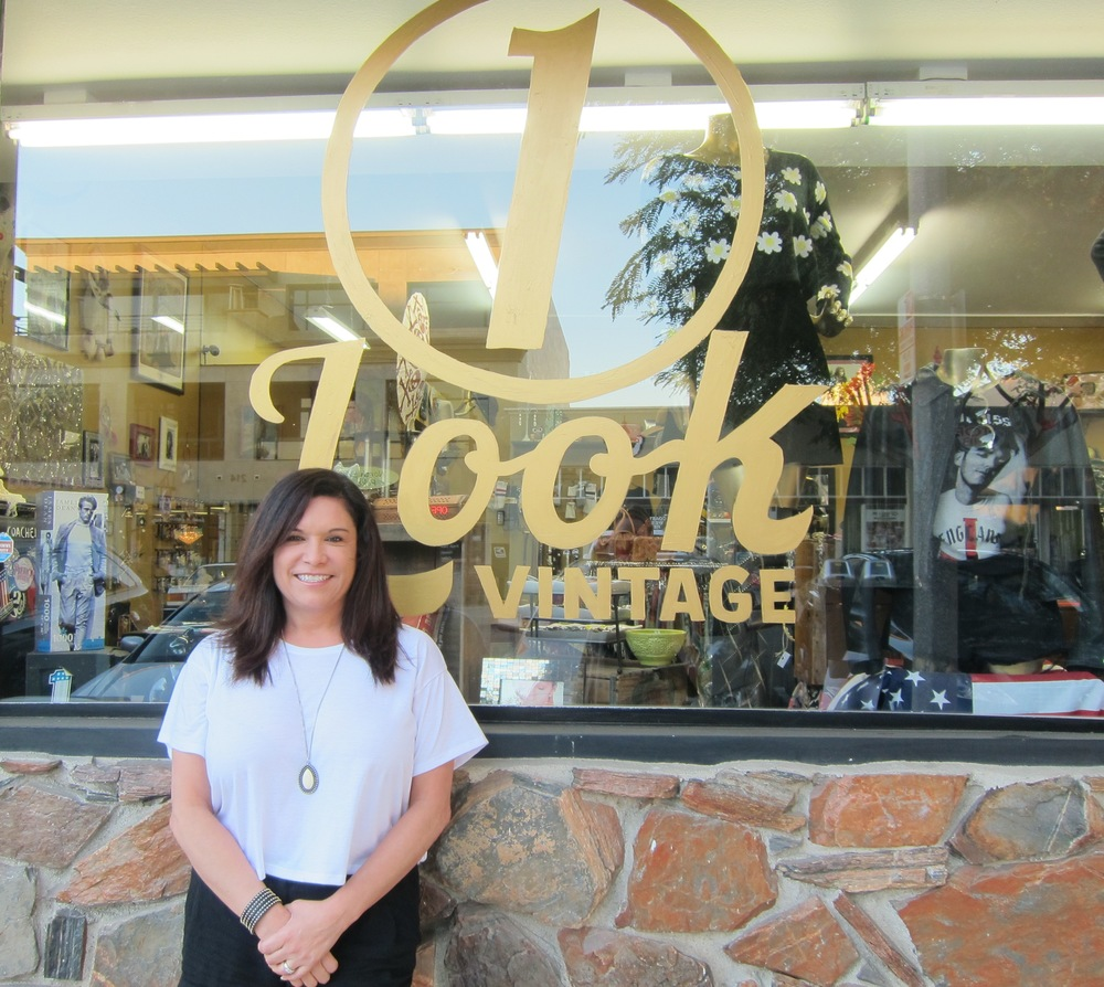 Owner Michelle Fechtig stands proudly in front of 1 Look Vintage  (Photo by Lauren Lloyd)