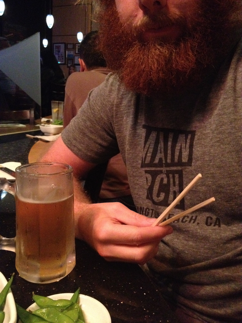 M&P reader and contributor Hudson Wise prefers his sushi, beer and beard with a side of tee  (Photo courtesy of Hudson Wise)