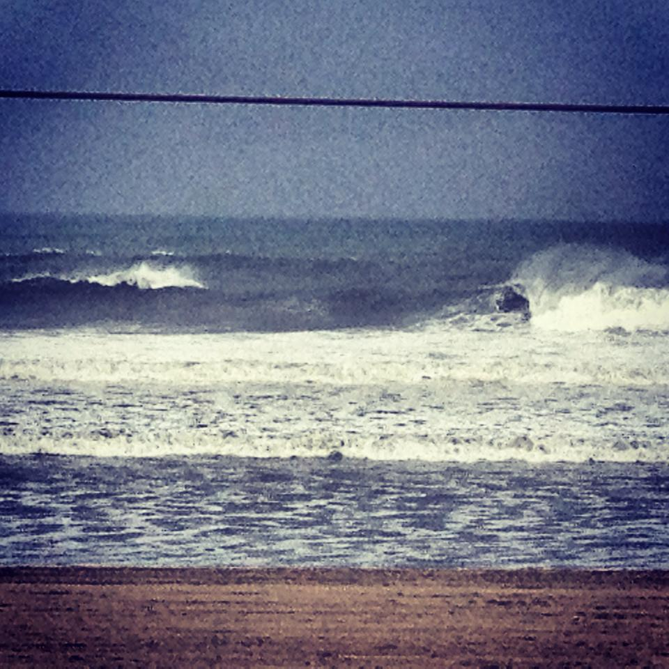 """Stormy choppy surf northside of the pier. No thanks""  (Photo by  Keith Shelley  of Surf City Skateboards)"