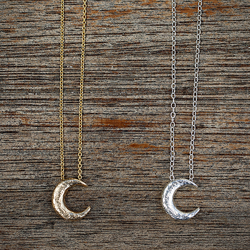 For the celestial mom: Tiny Recycled Sterling Silver & 14K Yellow Gold Crescent Moon Necklaces by Jan Palmer Designs, $50 & $270.  View in our Made In HB Marketplace .
