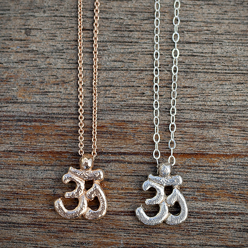 For the zen mom: Tiny Recycled Sterling Silver & 14K Rose Gold Om Necklaces by Jan Palmer Designs, $48 & $250. View in our Made In HB Marketplace .