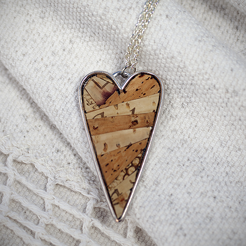 For the wine-loving mom: Recycled Wine Cork Mosaic Heart Necklace by Zona Sherman Designs, $32.  View in our Made In HB Marketplace .