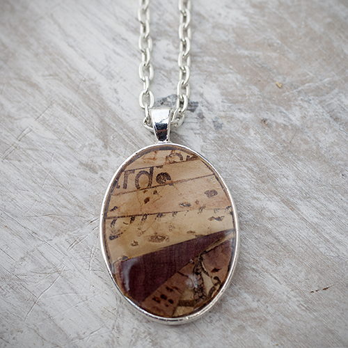 For the wine-loving mom: Recycled Wine Cork Mosaic Oval Necklace by Zona Sherman Designs, $32.  View in our Made In HB Marketplace .