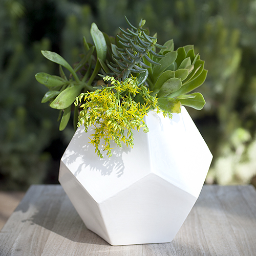 For the modern vintagemom: Versatile Ceramic Faceted Dodecahedron Vessel by Andrea Luna Reece, $60. View in our Made In HB Marketplace .