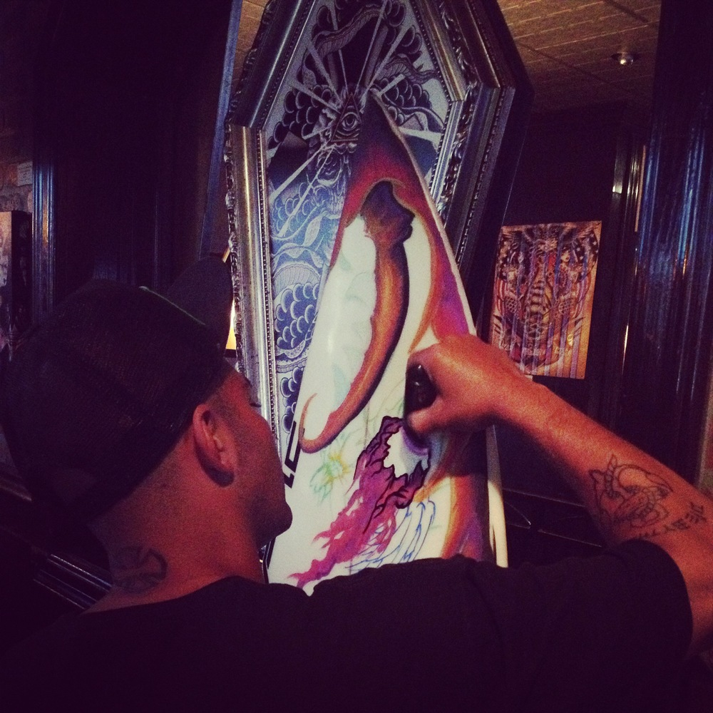 Chado  painting a board for a friend at 2nd Floor  (Photo by Lauren Lloyd)