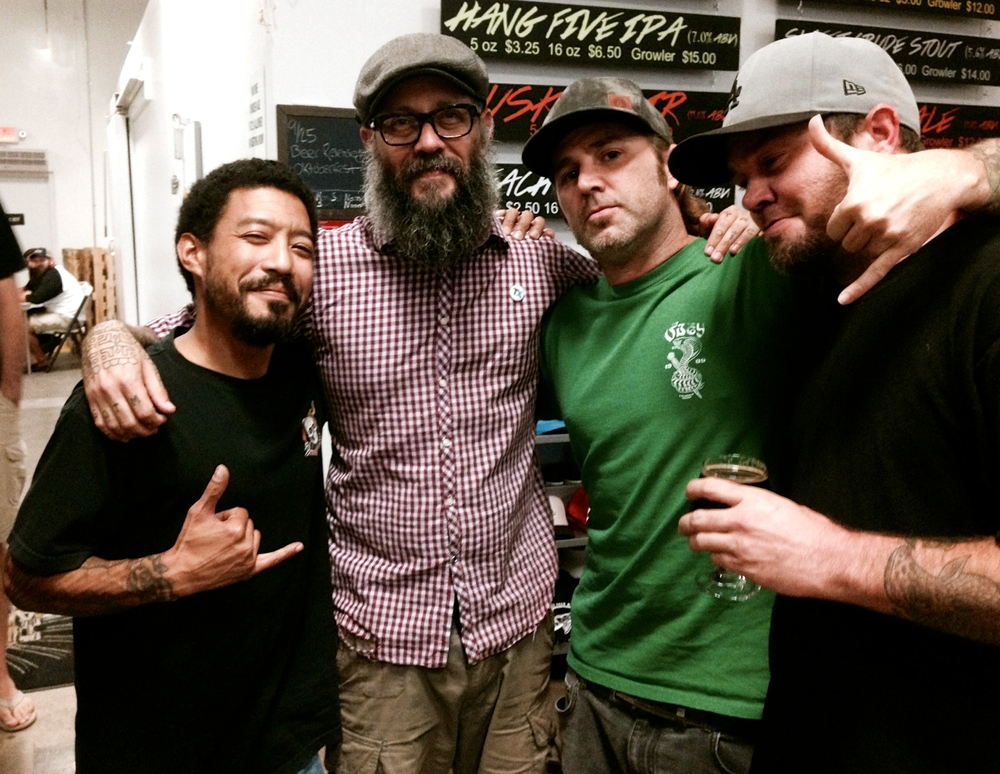 "Manly M&P Gents. From left: Darrell Norman of  Rollaway Grip ;  Hector ""Hek"" Valdez , tattooer at The Tattoo Gallery and 2014 HB City Council candidate; and Kris and Jay Brown of  Rollaway Grip   (Photo by Lauren Lloyd)"