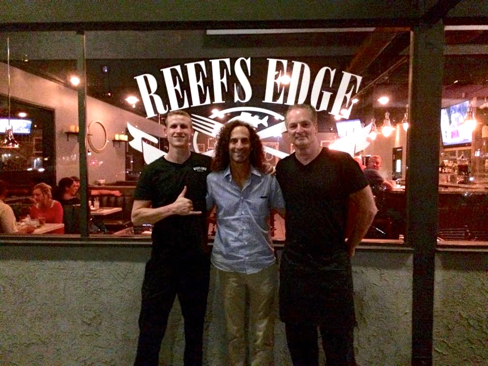 Celebrity moment at Reefs Edge Grill. From right: Chef Russ Troolines, Kenny G, and Chef Gary Schiffauer(Photo courtesy of Reefs Edge Grill)