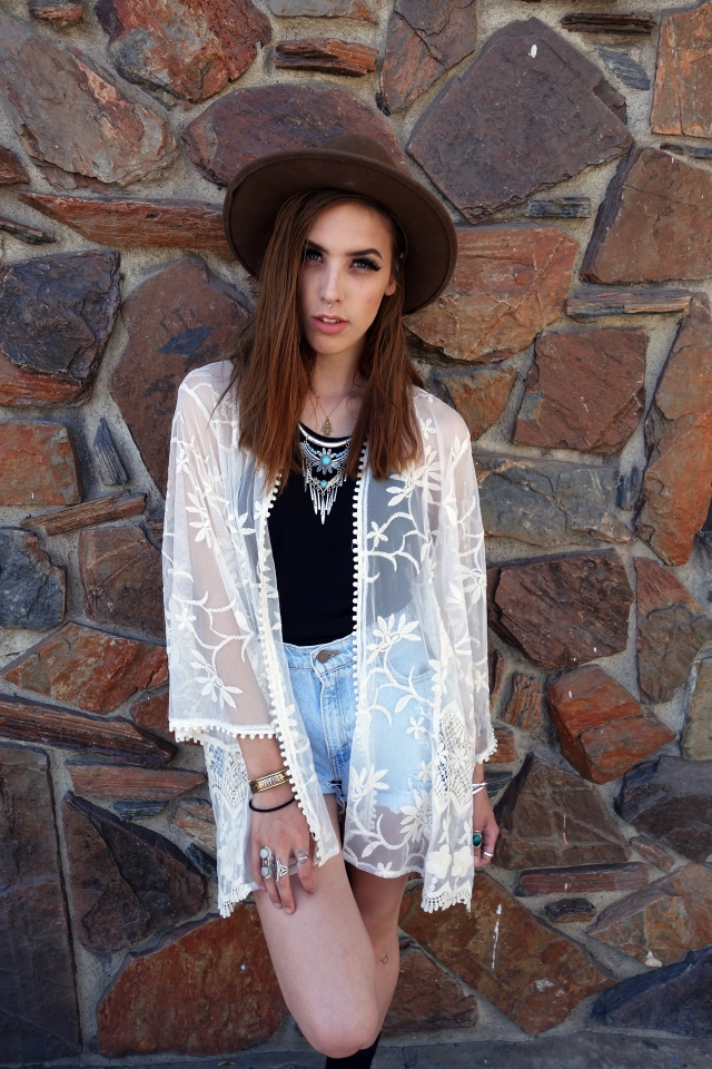 White Lace Kimono w/ Black T & High-Waisted Shorts    Lace and sheer kimonos usually breathe well, which is perfect for the desert heat.  $ // White lace kimono, $46 / Sunhat, $25 / Plain black tank, $18 / Shorts, $35 / Chunky necklace, $25