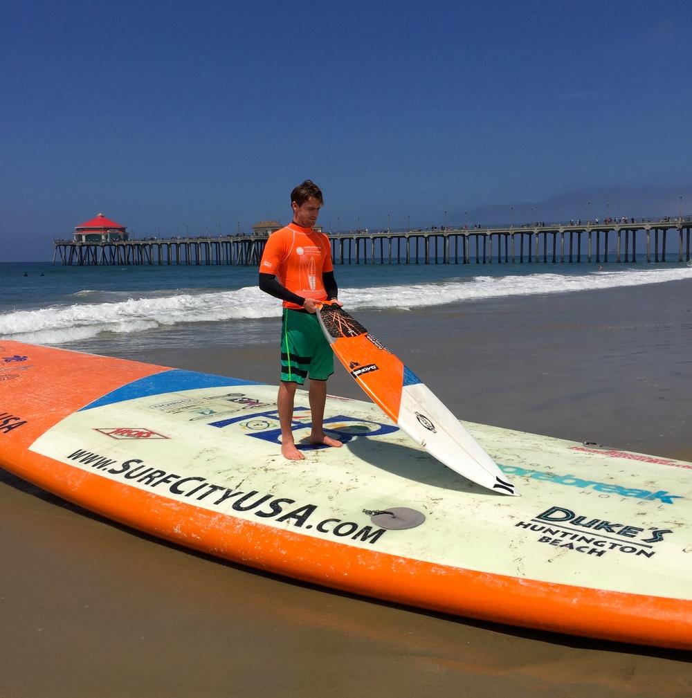Brett Simpson holds his short board, the stick Big Board HB mimics. (Photo by Lauren Lloyd)