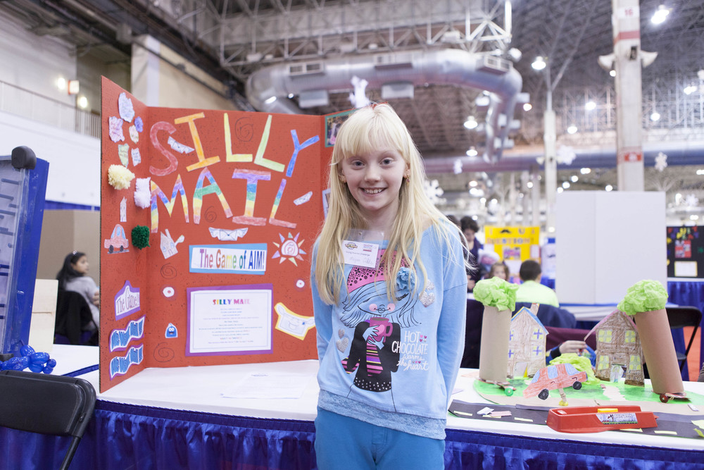 A budding young inventor shows off her original game idea at ChiTAG.