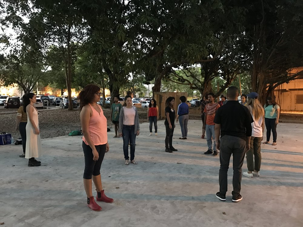Awareness exercise on site, front of the University of   Puerto Rico Women and Gender Studies Program with students from both our classes in the space of intervention.